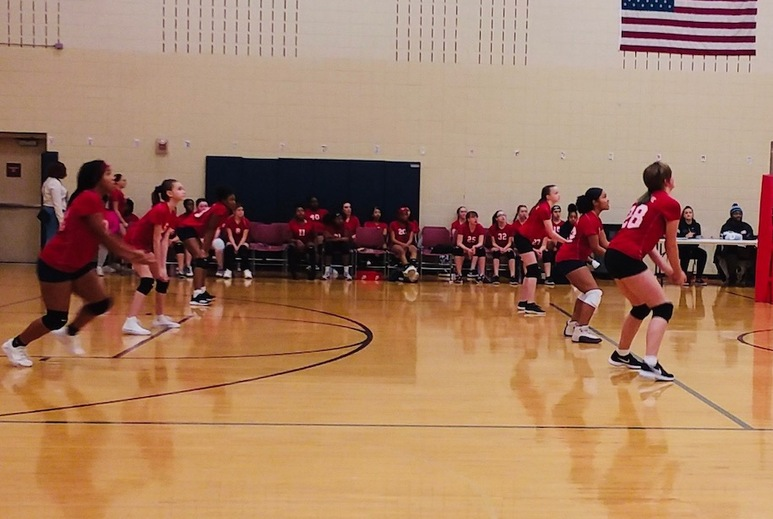 Girls in red shirts playing volleyball