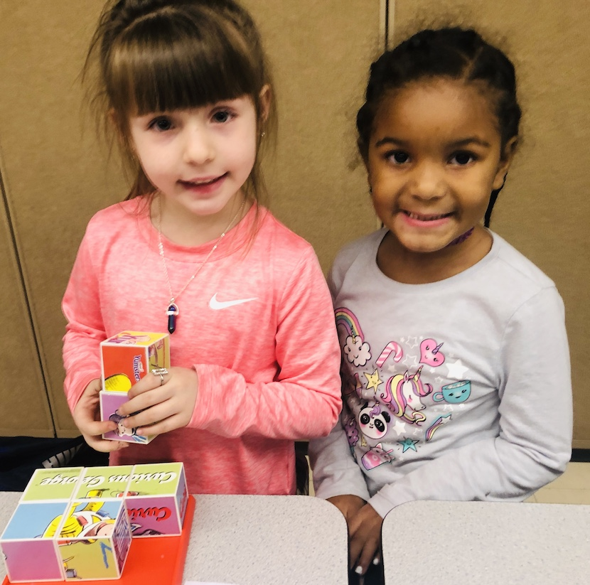 Two Girls Playing Blocks